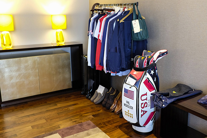 The bag and wardrobe for Phil Mickelson of Team USA sits in the Oakwood Premier Incheon, the official hotel for The Presidents Cup.