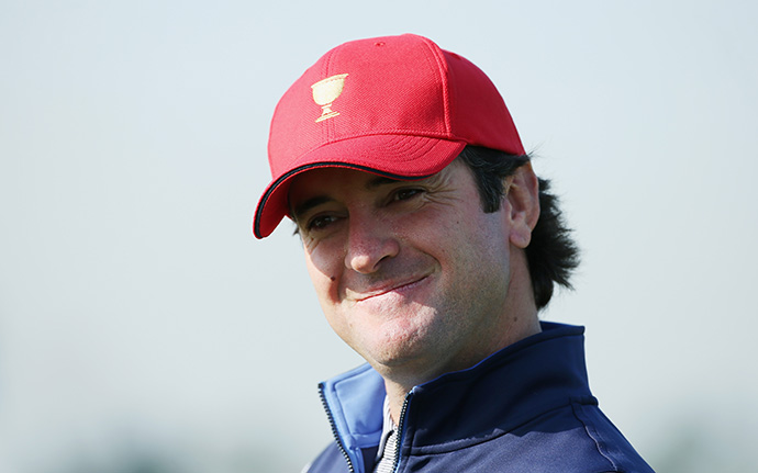 Bubba Watson of the United States team smiles while waiting on the practice ground with his team.