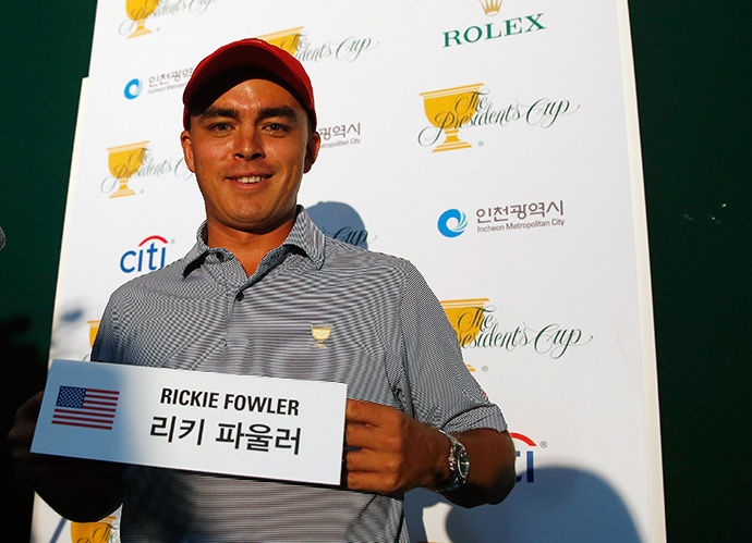 Rickie Fowler poses with his Korean name card during a press conference prior to the start of The Presidents Cup.