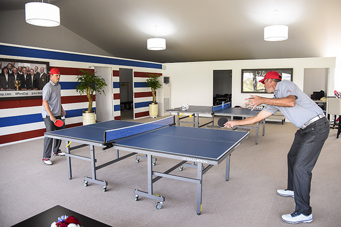 Team USA players Zach Johnson, left, and Matt Kuchar play ping pong in the team cabin before practice for The Presidents Cup.