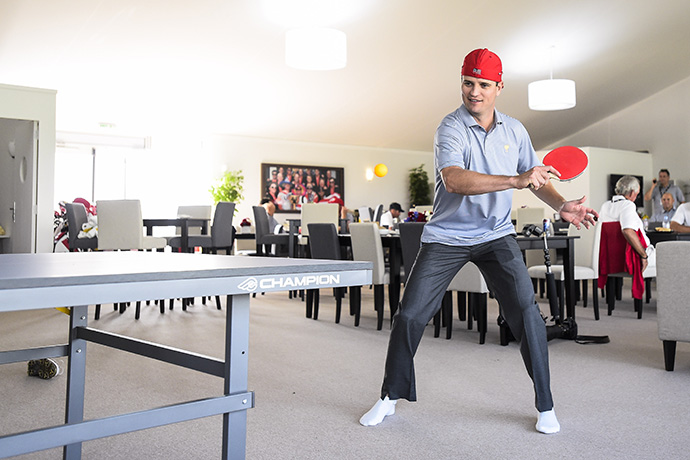 Zach Johnson plays ping pong in the team cabin.