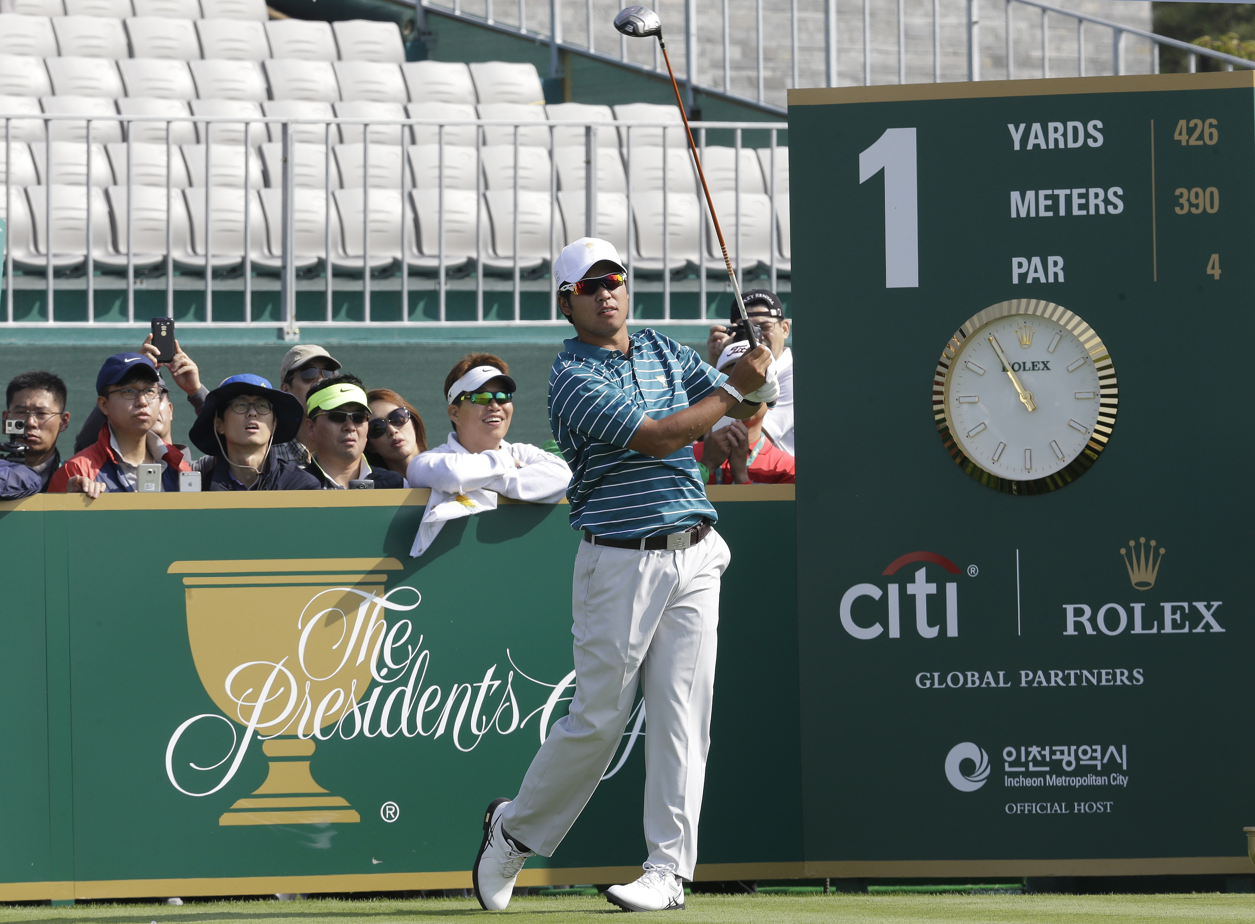 International team player Hideki Matsuyama watches his tee shot on the first hole during a practice round for the Presidents Cup golf tournament at Jack Nicklaus Golf Club Korea in Incheon, South Korea, Tuesday, Oct. 6, 2015. (AP Photo/Ahn