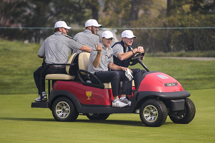 Team USA players J.B. Holmes, Dustin Johnson and Jordan Spieth get a ride from Captain's Assistant Jim Furyk during a practice round.