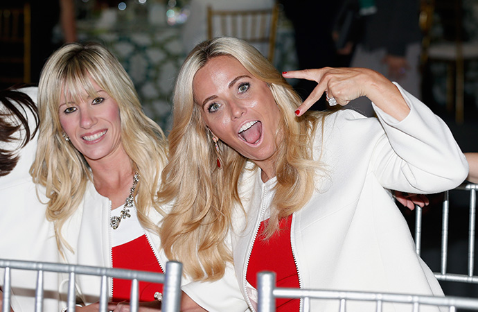 Amy Mickelson (R) and Justine Reed of the United States pose for a picture during the opening ceremony of the 2015 Presidents Cup.