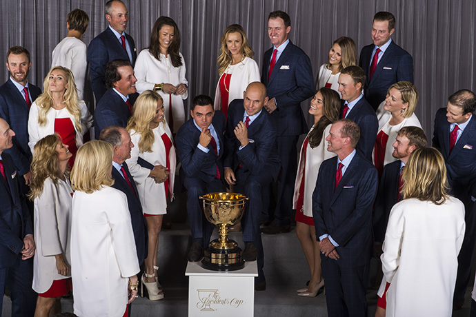 Rickie Fowler and Bill Haas, dateless, and members of Team USA share a laugh with their wives and girlfriends.