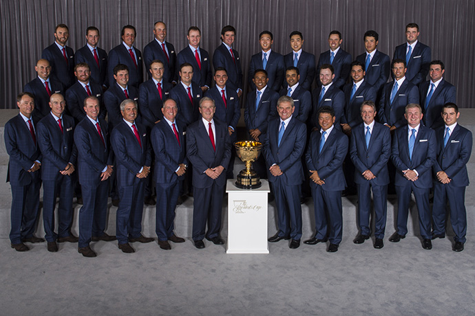 Former U.S. President George W. Bush poses for a group photo with members of Team USA and the International Team during The Presidents Cup Opening Ceremony.