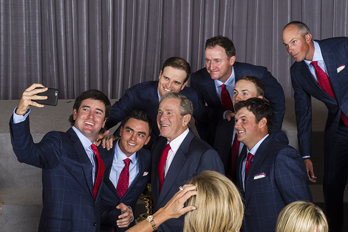 Former U.S. President George W. Bush takes a selfie with Team USA players Bubba Watson, Rickie Fowler, Zach Johnson, Jimmy Walker, Jordan Spieth, Patrick Reed and Matt Kuchar.