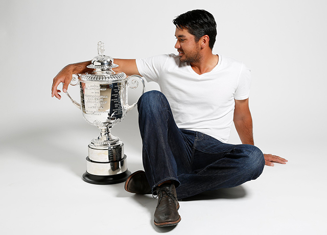 Jason Day poses with the Wanamaker Trophy.