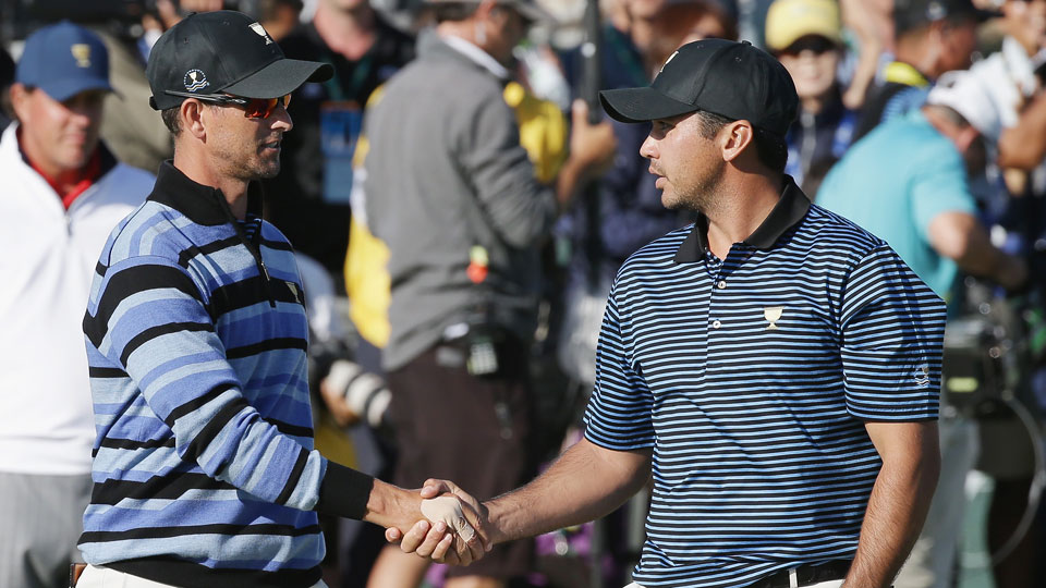 Adam Scott and Jason Day of Australia and the International Team shake hands on the 18th green after the Mickelson/Johnson and Day/Scott match was halved during the Friday four-ball matches at The Presidents Cup at Jack Nicklaus Golf Club Korea on October
