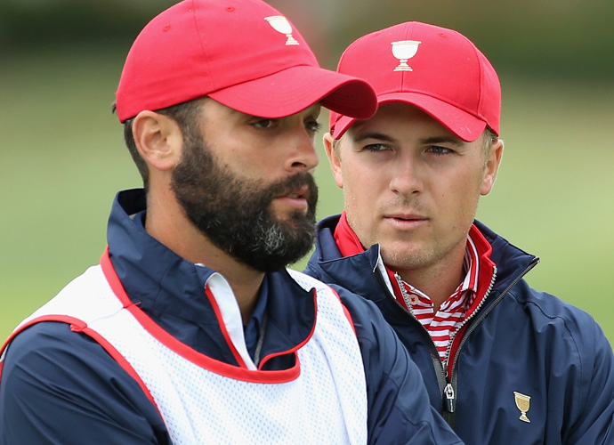 Jordan Spieth and caddie Michael Greller wait on the 14th green on Sunday.