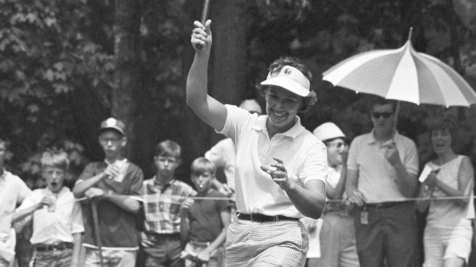 Sandra Spuzich lifts her leg high and cheers after sinking a putt on the 4th hole during the final round of the 1966 U.S. Woman's Open at Hazeltine National Golf Club on July 3, 1966, in Minneapolis, Minnesota. The 29-year-old won.