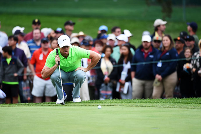 Rory McIlroy lines up a putt on the first hole during the third round of the Frys.com Open.