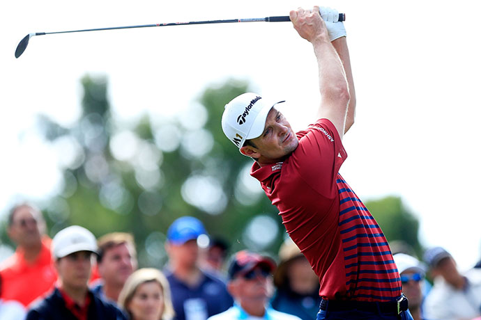 Justin Rose plays his shot from the second tee during the third round of the Frys.com Open.