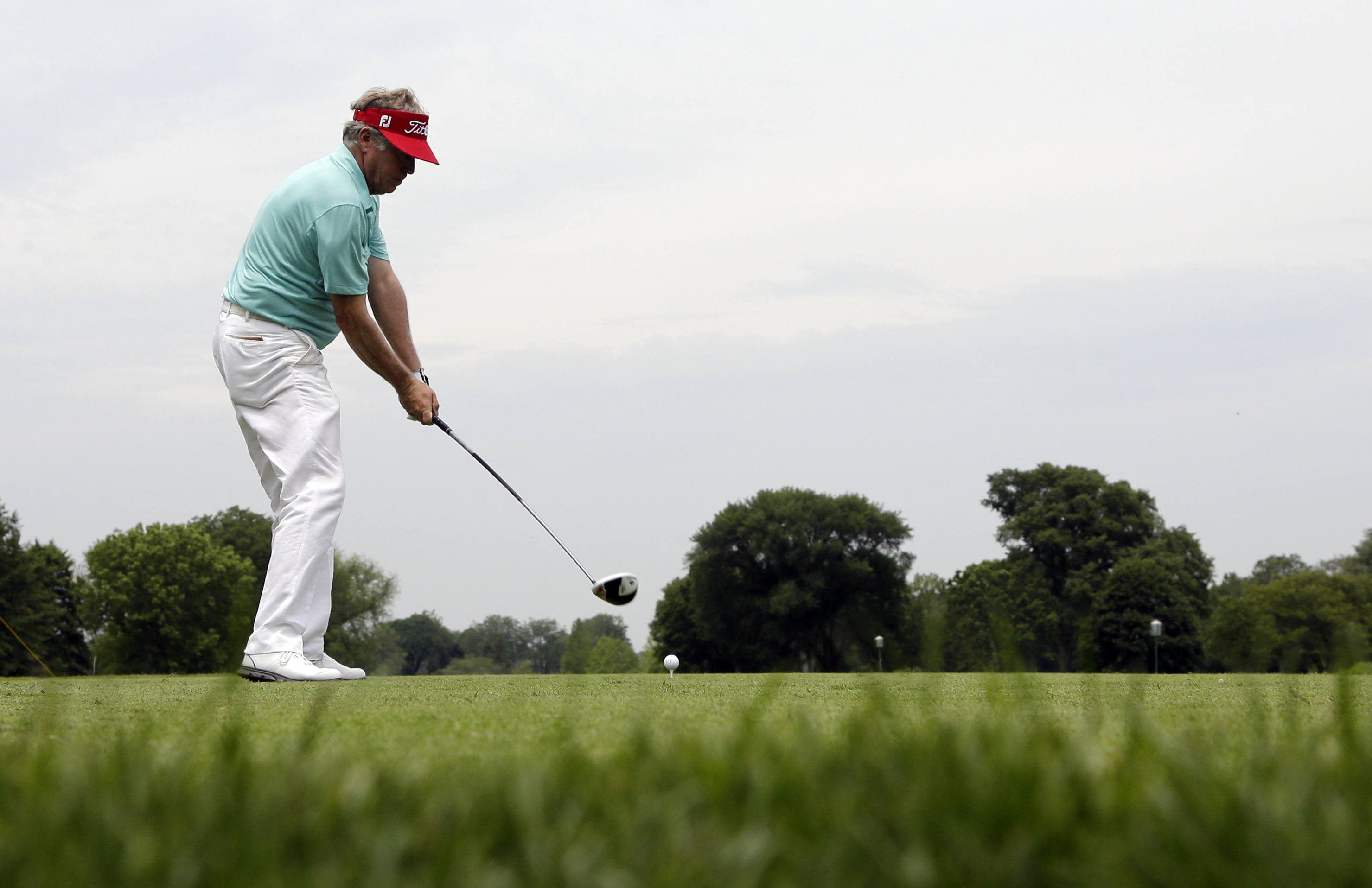 Michael Allen hits a tee shot on the third during the second round of the Encompass Championship golf tournament Saturday, July 11, 2015, in Glenview, Ill. (AP Photo/Nam Y.