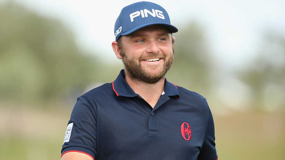 Andy Sullivan of England smiles on the 15th hole during the final round of the Portugal Masters at Oceanico Victoria Golf Club on Oct. 18, 2015, in Albufeira, Portugal.