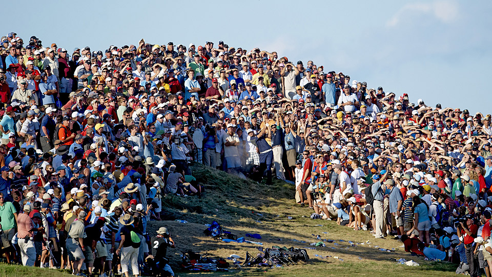 Dustin Johnson hits out of a waste bunker at the 2010 PGA Championship.