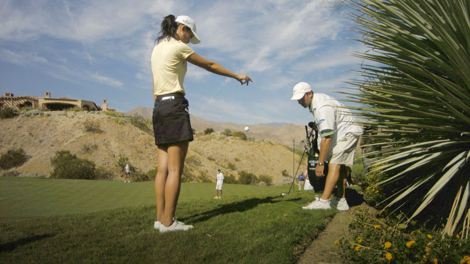 Michelle Wie makes an illegal drop that would result in her disqualification from the 2005 Samsung World Championship.