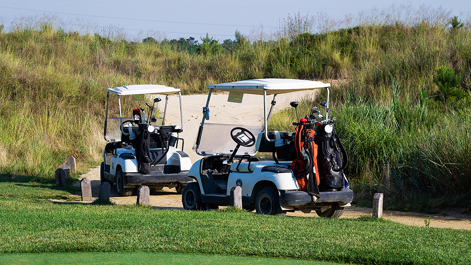 Golf carts parked at a course in New Jersey.