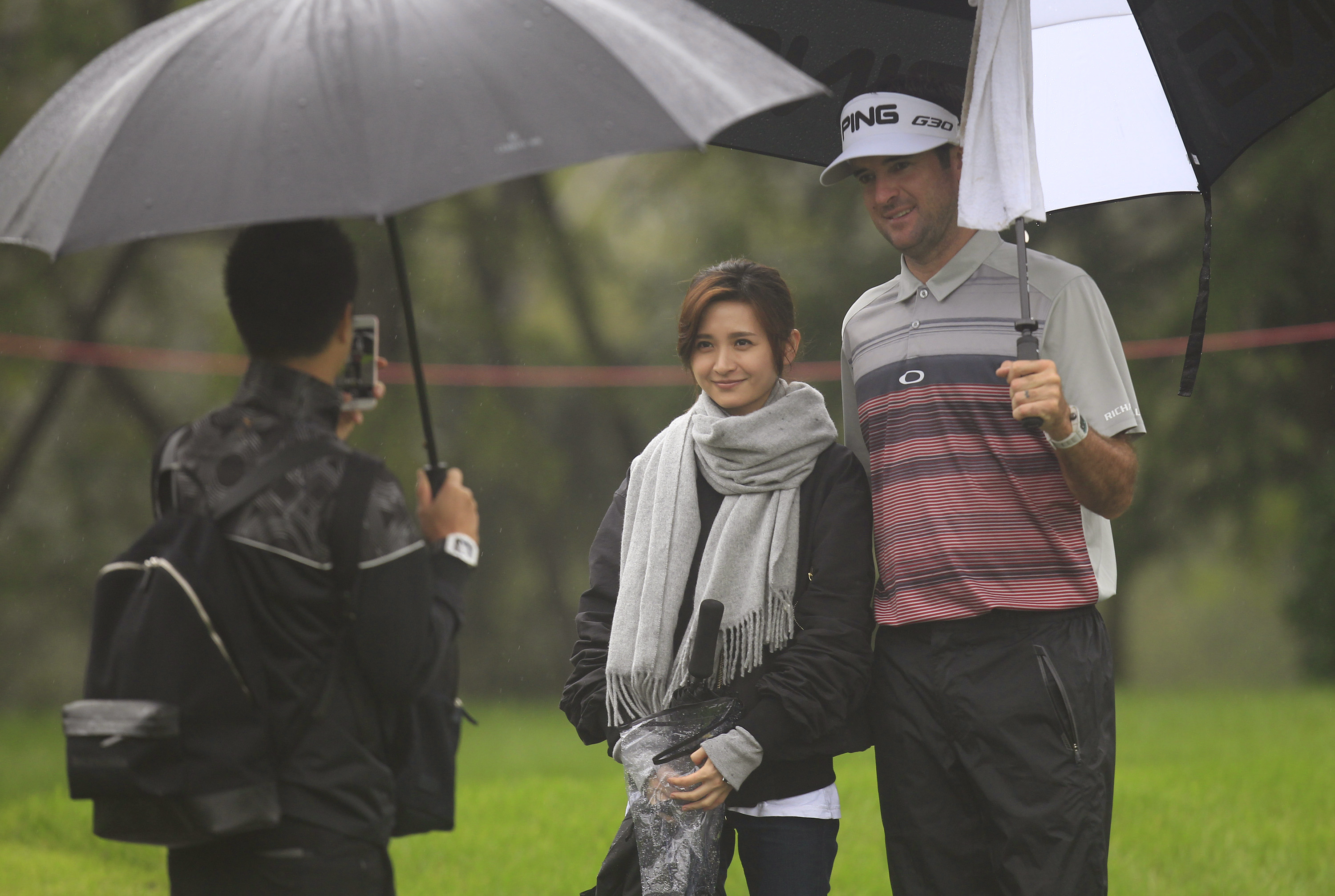 Bubba Watson poses for a photo with a spectator during the SBC Champions Pro-Am.