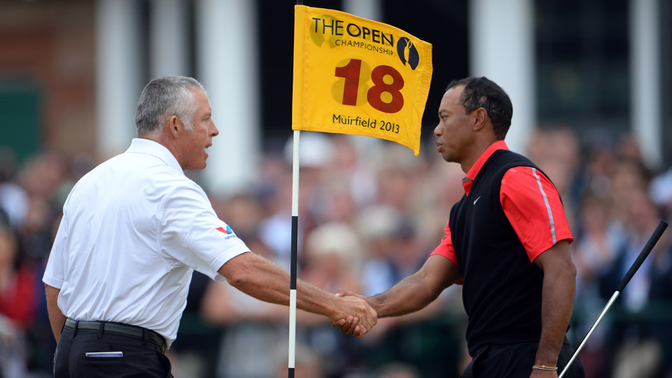 Caddie Steve Williams and Tiger Woods shake hands after a round at the 2013 Open Championship.