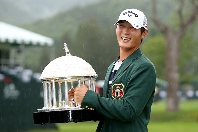 Danny Lee poses with the trophy after winning the Greenbrier Classic on the second hole of a sudden death playoff on July 5, 2015 in White Sulphur Springs, West Virginia.