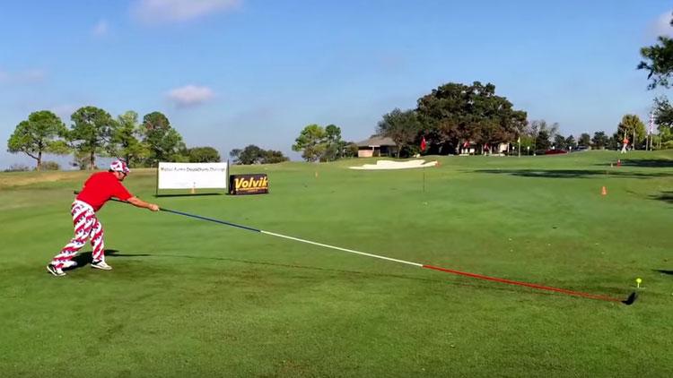 Michael Furrh tests out his very long golf club.