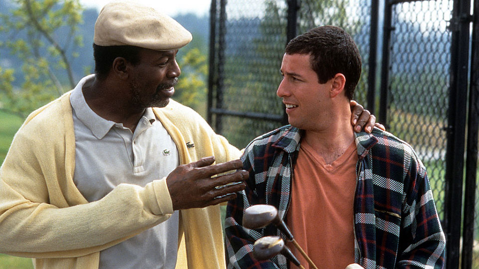 Carl Weathers and Adam Sandler in the 1996 movie Happy Gilmore.