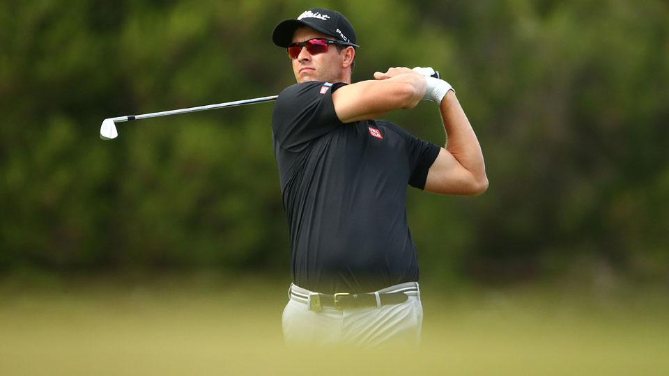 Adam Scott plays an approach shot on the 17th hole during the opening round of the Australian Masters.