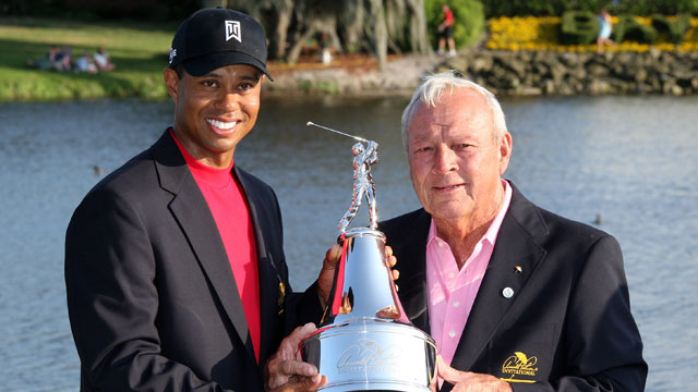 Tiger Woods (left) celebrates with Arnold Palmer after sinking his final putt for birdie to win the Arnold Palmer Invitational at the Bay Hill Club and Lodge in Orlando, Florida.
