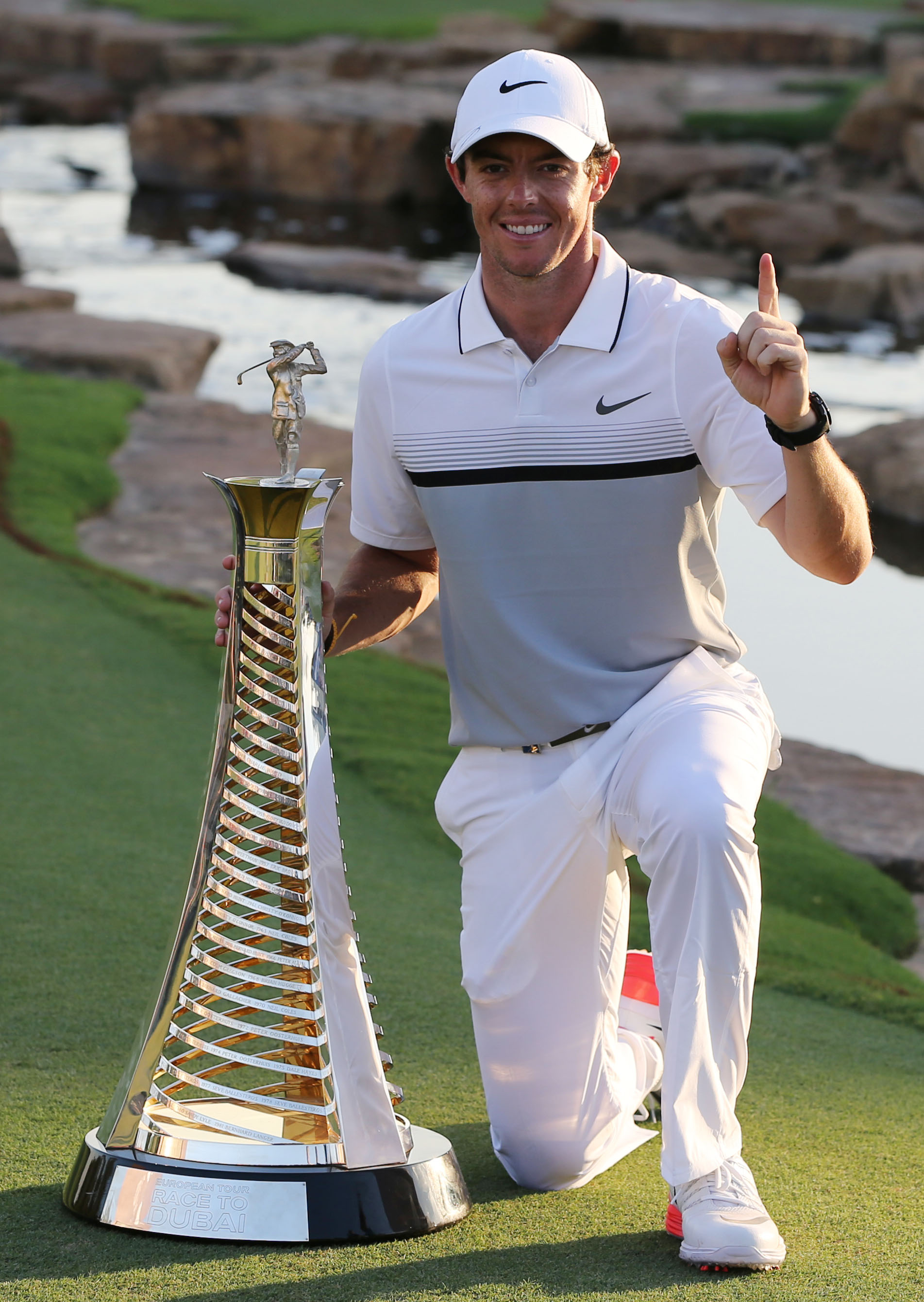 Rory McIlroy poses with the Race to Dubai trophy after winning the DP World Tour Championship.