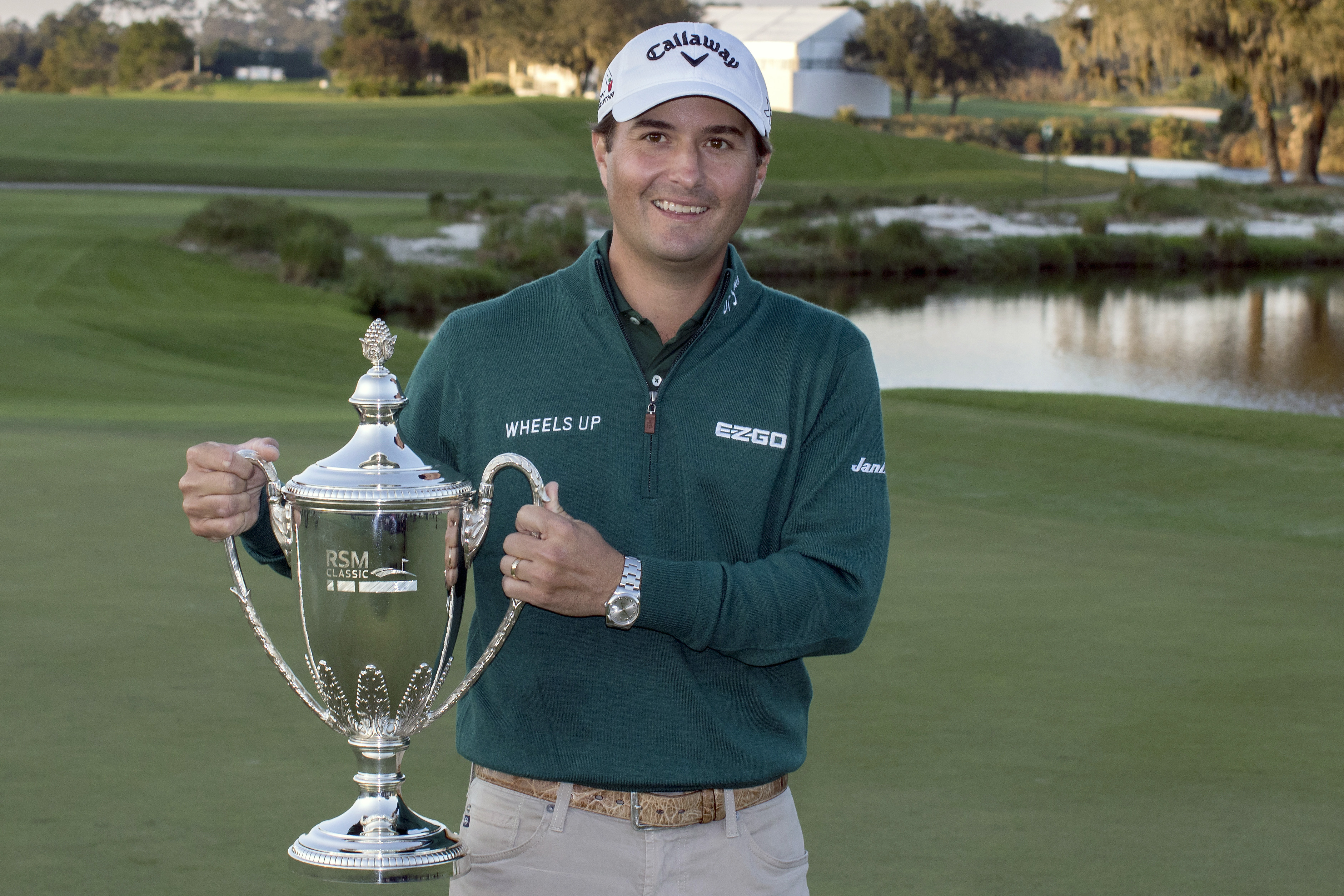 Kevin Kisner holds the RSM Classic trophy after his winning the final round at the RSM Classic golf tournament Sunday, Nov. 22, 2015, in St. Simons Island, Ga. (AP Photo/Stephen B.