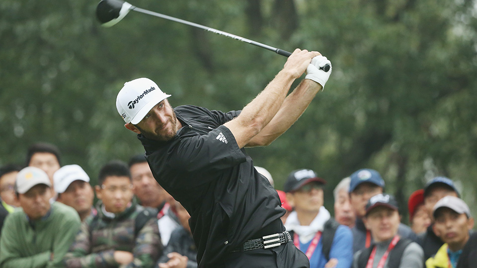 Dustin Johnson hits his tee shot on the 13th hole during the final round of the 2015 WGC - HSBC Champions.