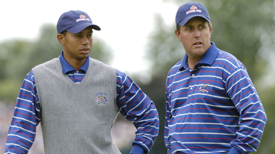 Tiger Woods and Phil Mickelson wait for play   during  four-ball competition at    the 2004 Ryder Cup in Detroit, Michigan, September 17, 2004.
