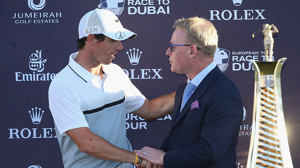 Rory McIlroy of Northern Ireland and Keith Pelley, Chief Executive of The European Tour, are pictured together with the Race To Dubai trophy following the final round of the DP World Tour Championship.