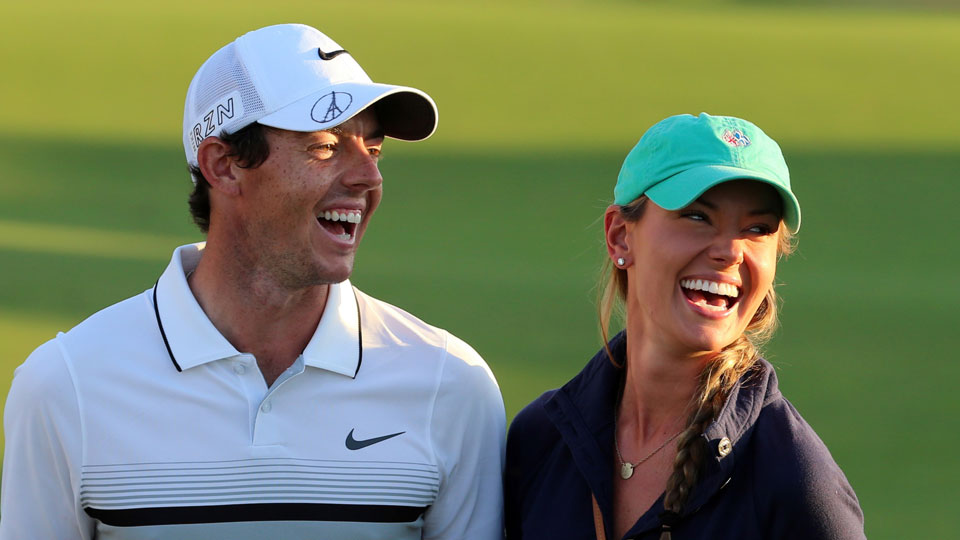 Rory McIlroy celebrates winning the the DP World Tour Golf Championship with his girlfriend Erica Stoll.