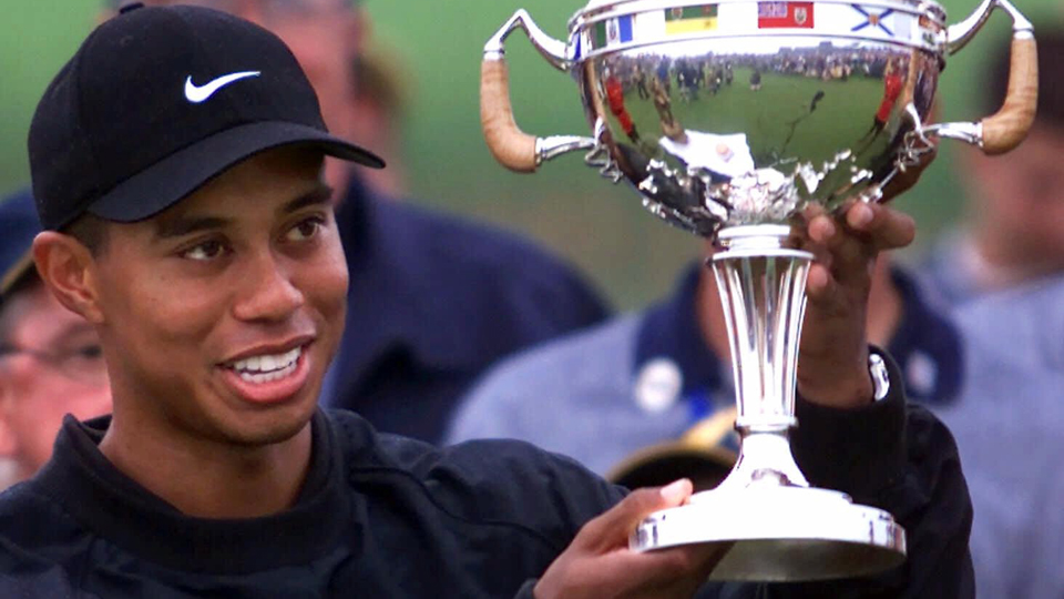 Tiger Woods hoists the Canadian Open trophy after winning the championship at Glen Abbey in Oakville, Ontario, on Sept.10, 2000.