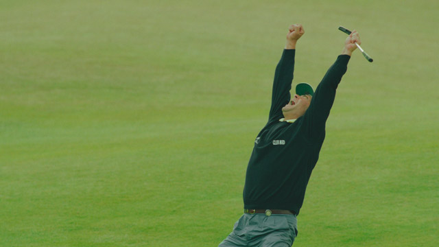 Costantino Rocca of Italy celebrates his birdie putt on the 18th green to force a playoff with John Daly on 23 July 1995 during the Open Championship at the Old Course at St Andrews in St Andrews, Scotland.