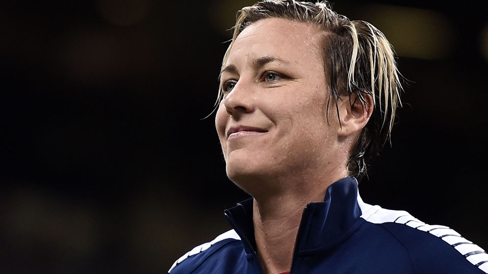 Abby Wambach stands for player introductions prior to the women's soccer match against China at the Mercedes-Benz Superdome on Wednesday, Dec. 16, 2015, in New Orleans, Louisiana.