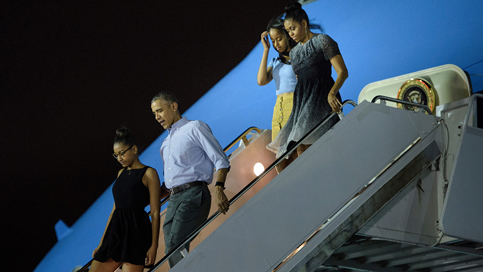 The First Family arrive at Hickam Air Force Base in Honolulu, Hawaii for their annual vacation on December 19, 2015.