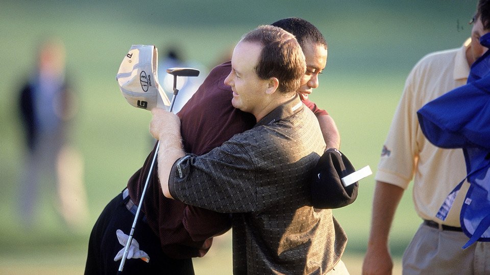 Tiger Woods and Boby May embrace after the 2000 PGA Championship.