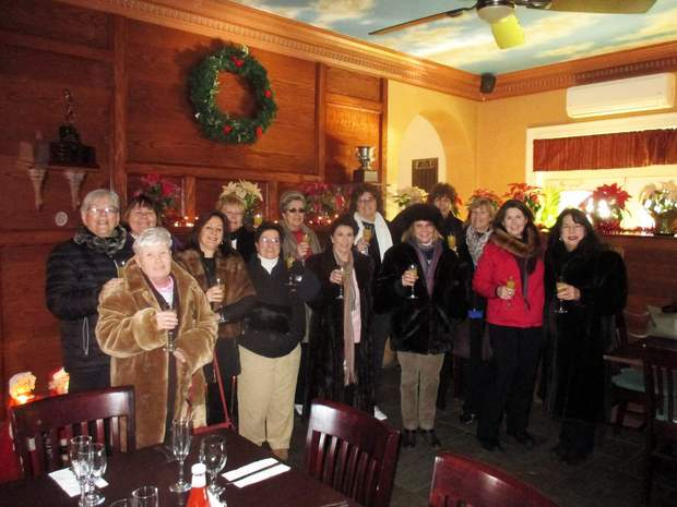 The participants gather by a fireplace before heading out in the cold at the fifth annual Mink Open.