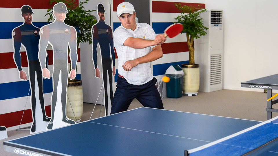 Jordan Spieth plays ping pong in the U.S. team room following the first round of matches the 2015 Presidents Cup in South Korea.