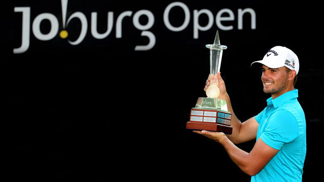Haydn Porteous with the winner's trophy at the Joburg Open.