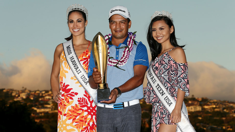 Fabian Gomez poses for cameras after winning the Sony Open.