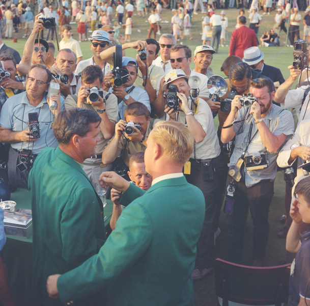 Press photographers document Jack Nicklaus presenting Gay Brewer Jr. the green jacket after the 1967 Masters.