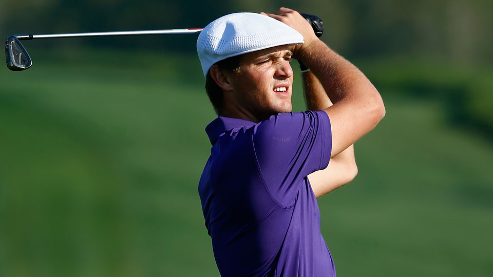 Bryson DeChambeau plays his approach shot on the third hole during the opening round of the Abu Dhabi HSBC Golf Championship.