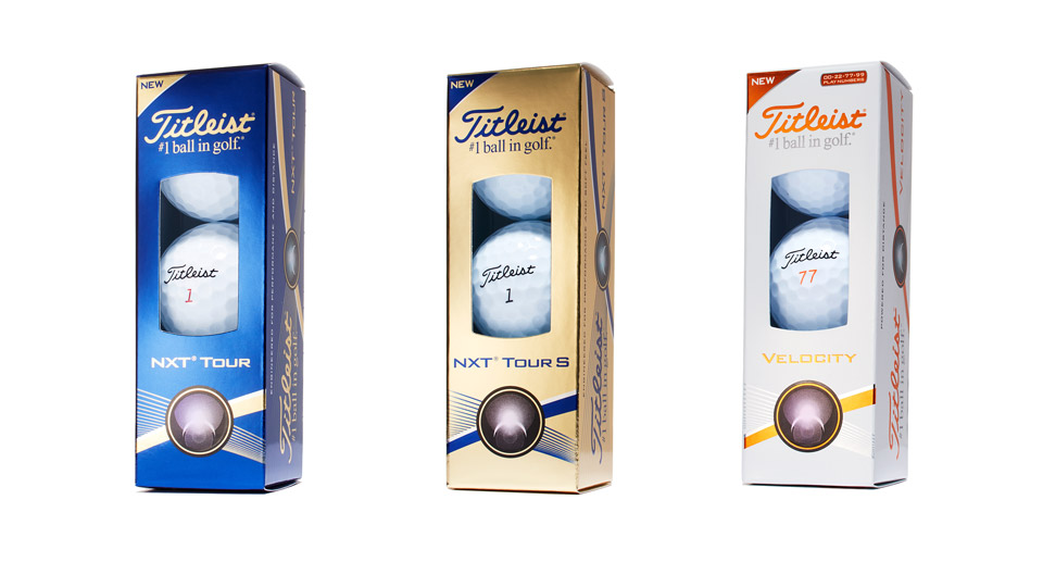 The new Titleist NXT Tour, NXT Tour S and Velocity golf balls in their sleeves.