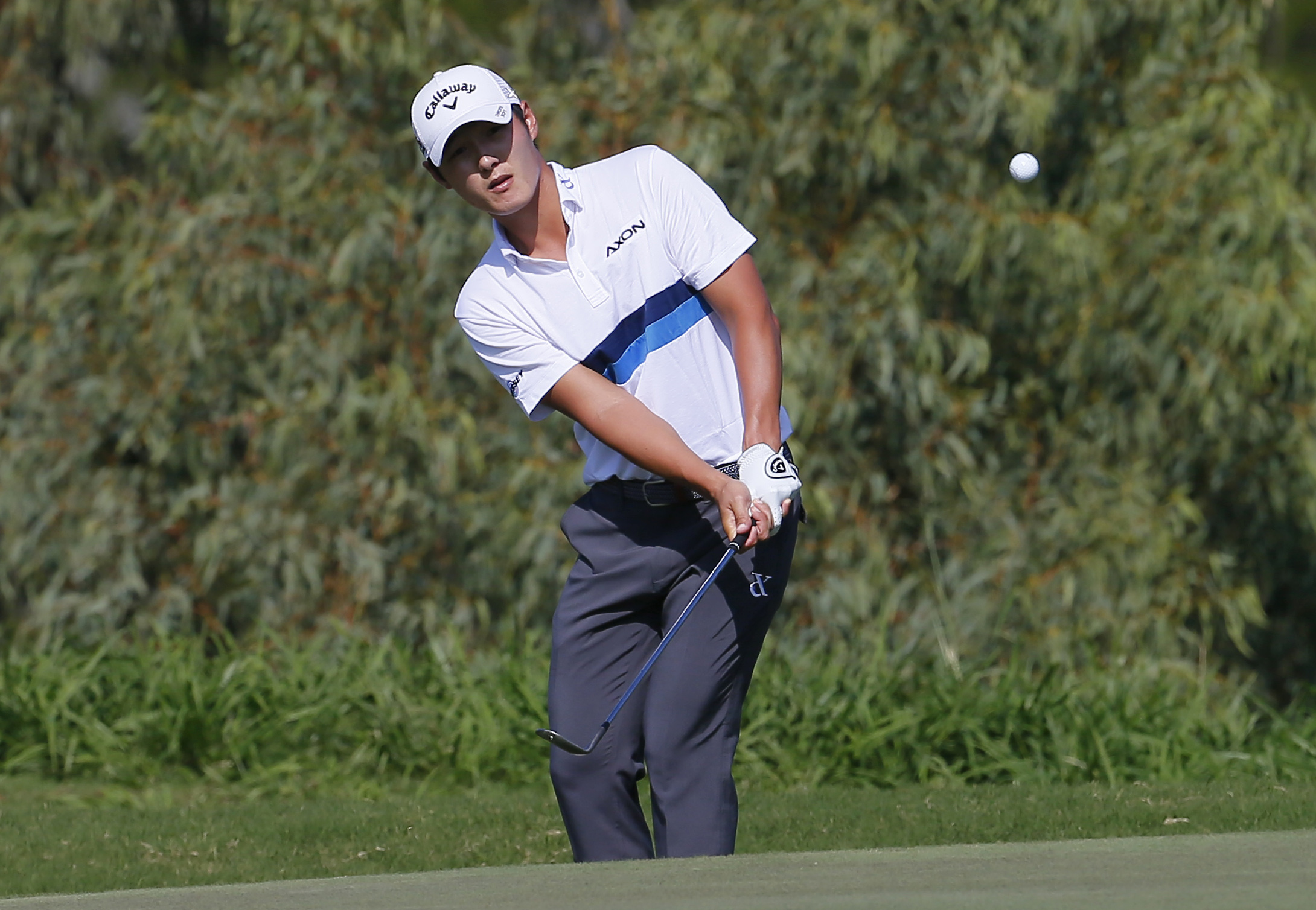 Danny Lee chips up onto the fourth green during the second round of the Tournament of Champions golf event Friday, Jan. 8, 2016, at Kapalua Plantation Course in Kapalua, Hawaii.