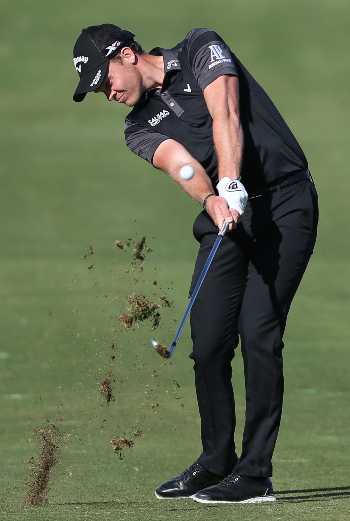 Danny Willett of England plays a shot on the 14th hole during 3rd round of the Dubai Desert Classic golf tournament in Dubai, United Arab Emirates, Saturday, Feb. 6, 2016.