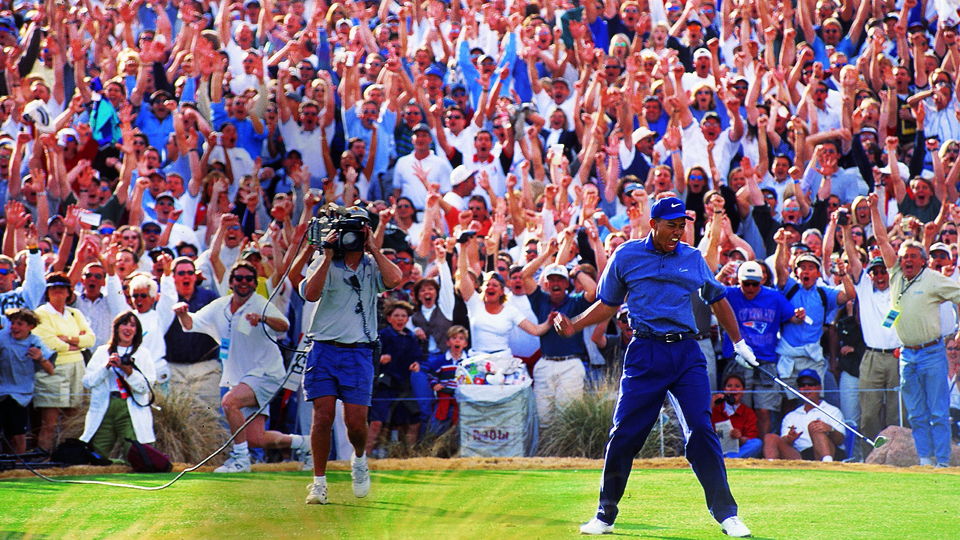 Tiger Woods and the crowd celebrate Woods' ace on the 16th hole during the 1997 Phoenix Open.